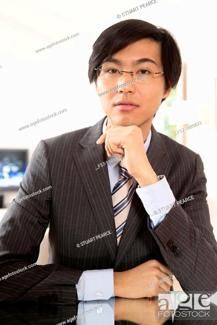 Stock Photo: Expressive young Asian businessman.