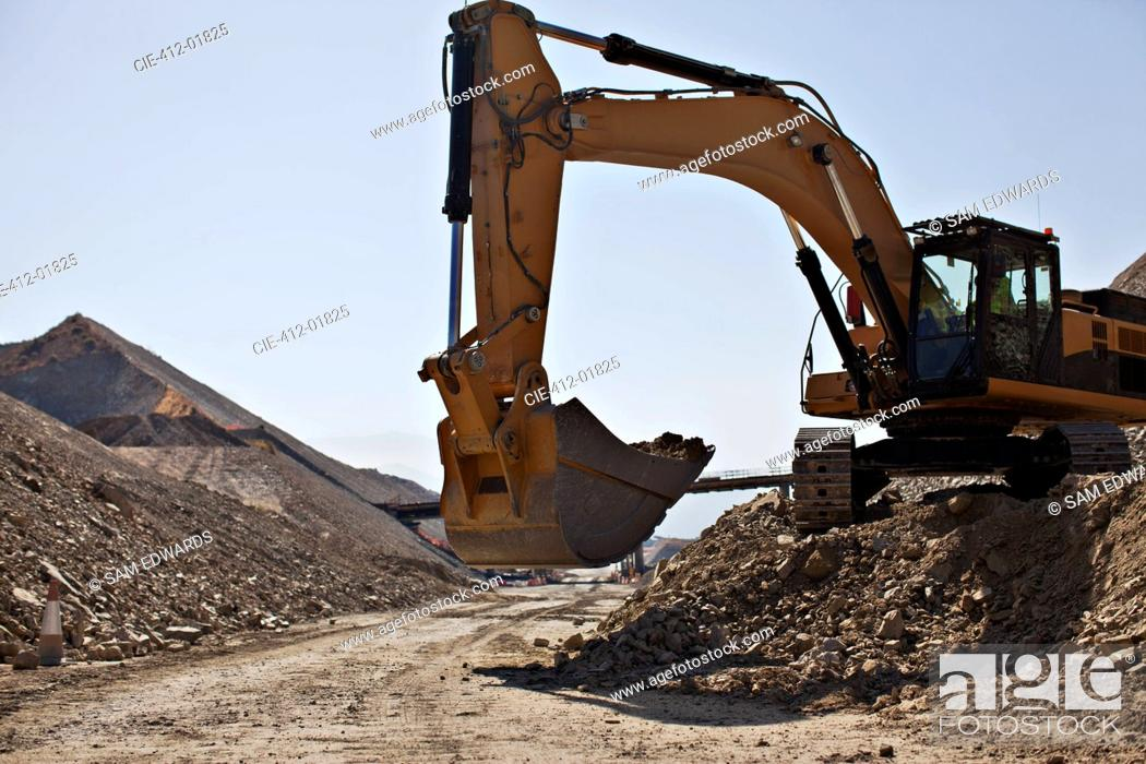 Stock Photo: Digger working in quarry.