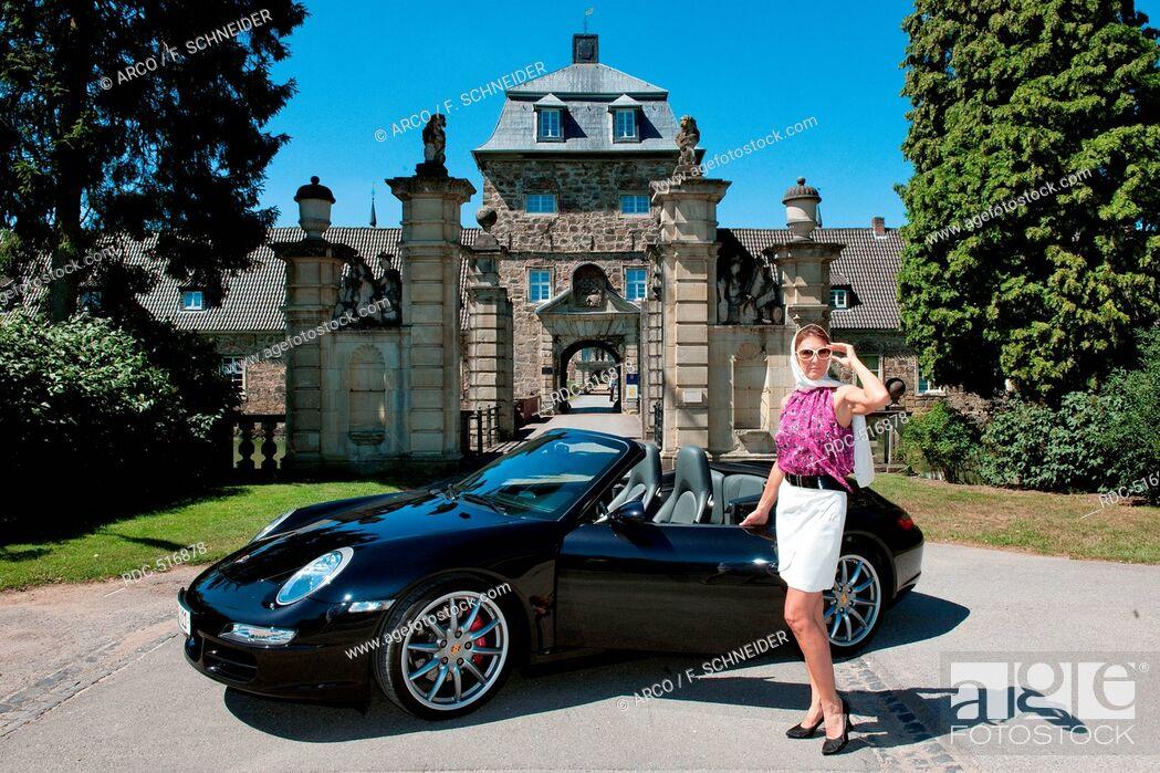 Stock Photo: stylish woman and Porsche 911 in front of castle, 911 carrera, 4S, convertible car, sportscar, luxurious.