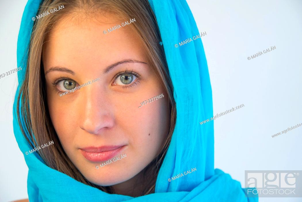 Stock Photo: Portrait of blonde young woman wearing turquoise shawl.