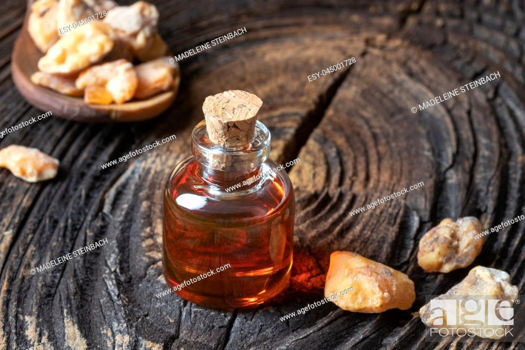 Stock Photo: A bottle of styrax benzoin essential oil and resin.
