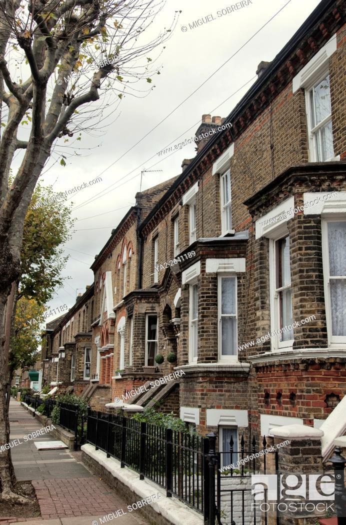 Stock Photo: Row of Brick terraced Houses.