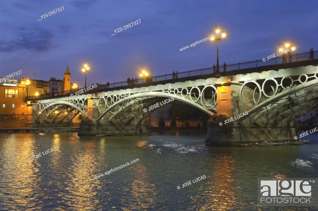 Stock Photo: Triana bridge and Guadalquivir river at dusk, Seville, Region of Andalusia, Spain, Europe.