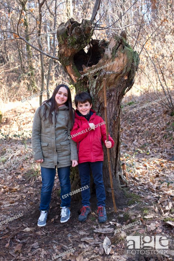Stock Photo: portrait of children in the forest while they are on an excursion in winter.