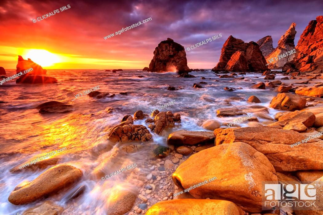 Stock Photo: Breathtaking Sunset over Beach Ursa, Sintra, Portugal.