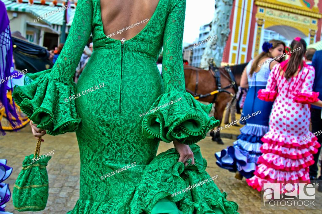 Stock Photo: A Woman wearing flamenco dress at the April Fair in Seville, Spain.