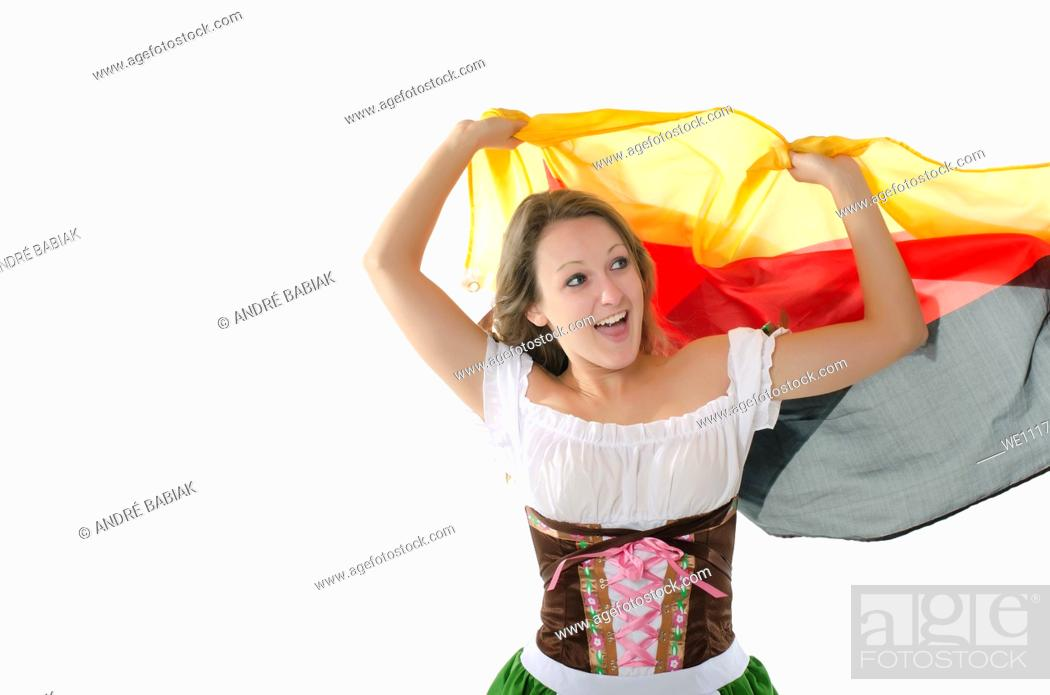 Stock Photo: Young woman in dirndl dress cheering with Germany flag.
