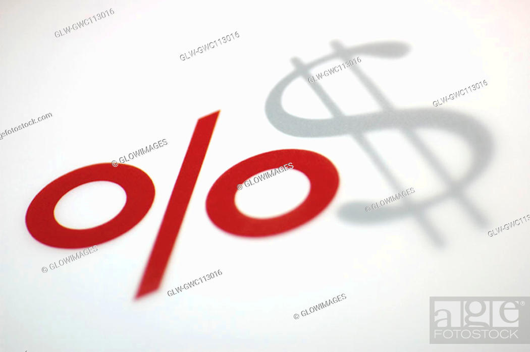 Stock Photo: Close-up of a percentage sign and a dollar sign.