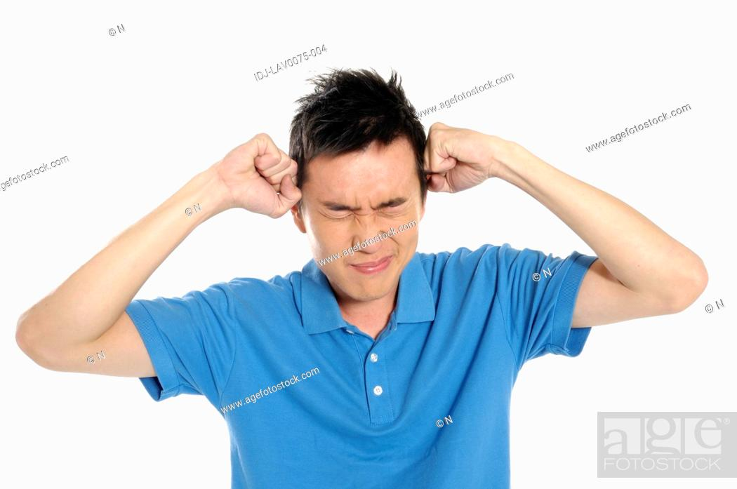 Stock Photo: Male university student suffering from a headache.