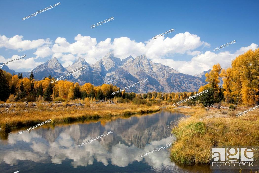 Stock Photo: Mountains and landscape reflected in still river.