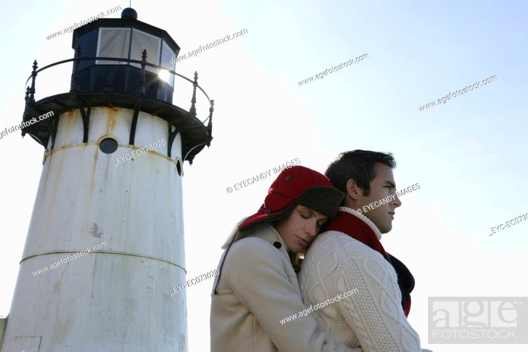 Stock Photo: Affectionate couple at lighthouse.