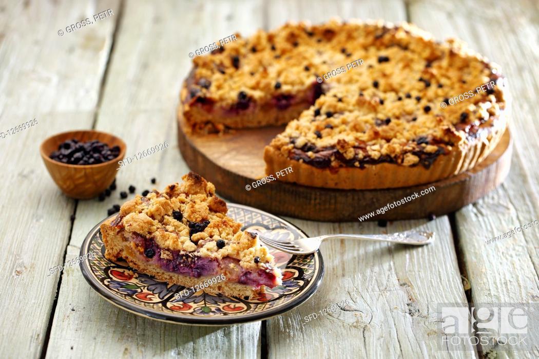 Photo de stock: Blueberry crumble cake, sliced.