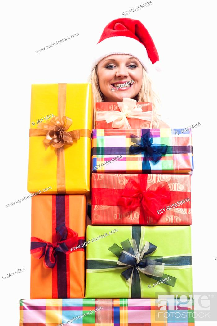 Stock Photo: Cheerful Christmas woman with many presents, isolated on white background.