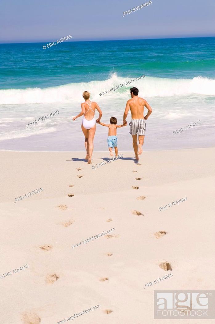 Stock Photo: Family running on the beach.