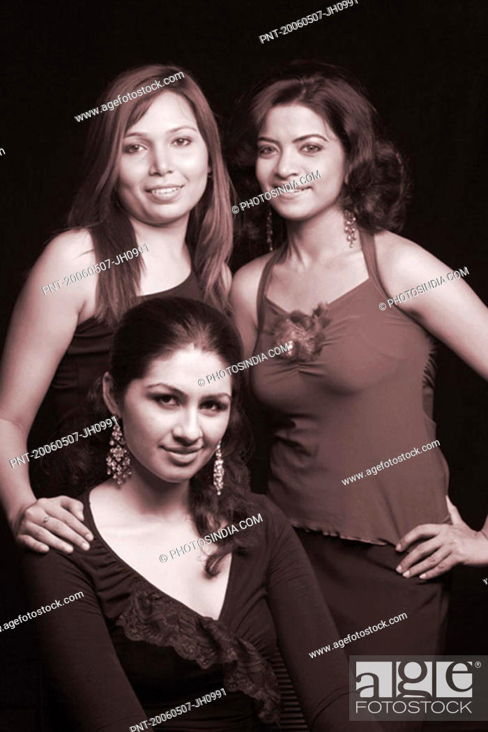 Stock Photo: Portrait of three young women smiling.