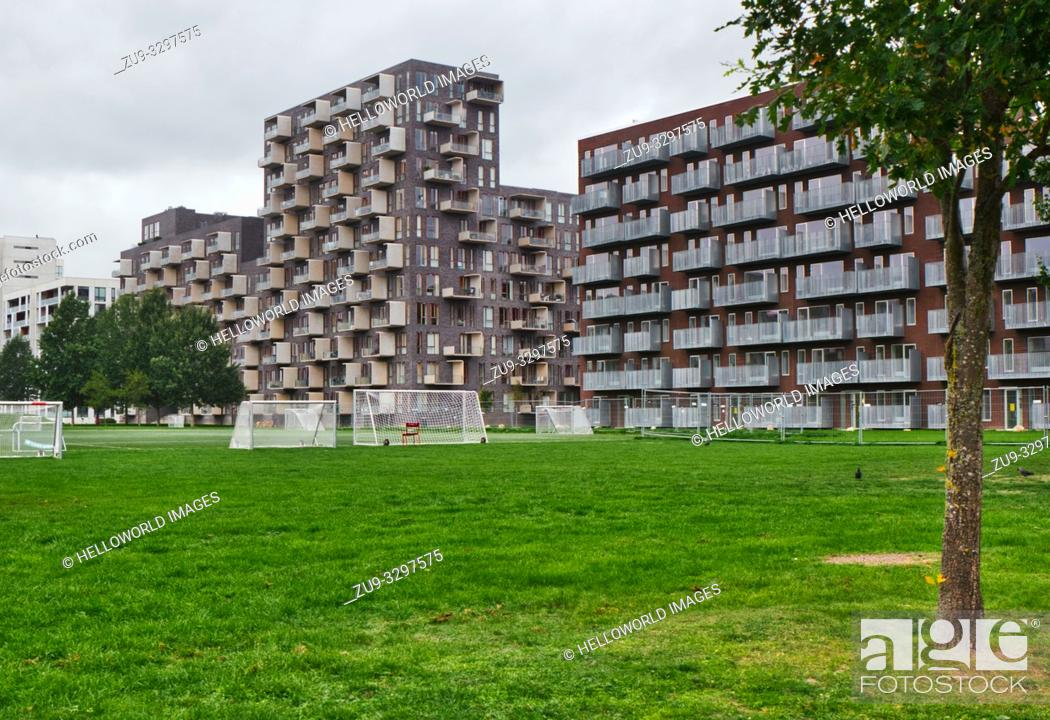 Stock Photo: Urban apartments with balconies, Orestad, Copenhagen, Denmark, Scandinavia. Orestad is a developing city/new town on the island of Amager.