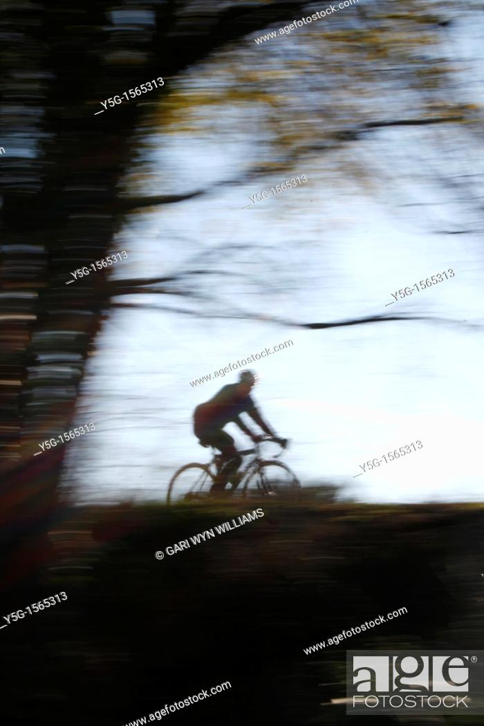 Stock Photo: person riding fast bike in countryside in rome italy.