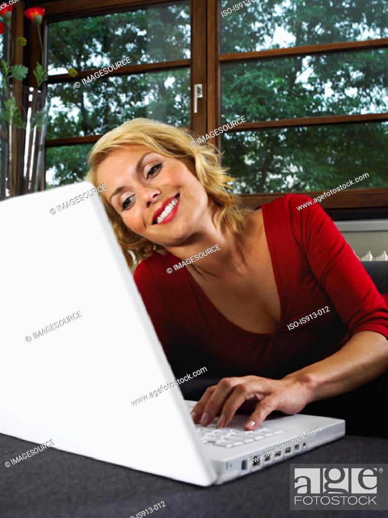 Stock Photo: Woman using laptop computer.