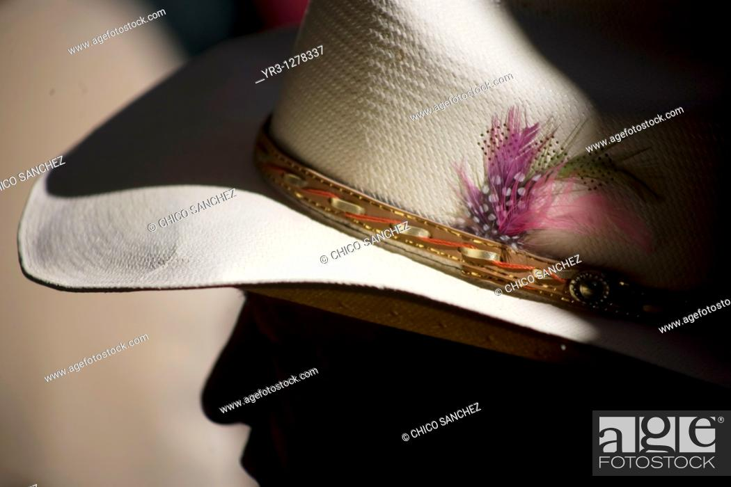 Stock Photo: Feathers decorate a cowboy hat of a spectator at the National Charro Championship in Pachuca, Hidalgo State, Mexico. Escaramuzas are similar to US rodeos.