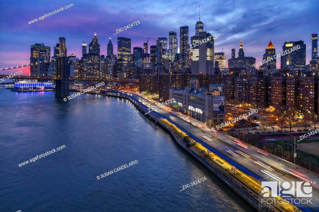 Stock Photo: Brooklyn Bridge and Lower Manhattan Skyline.