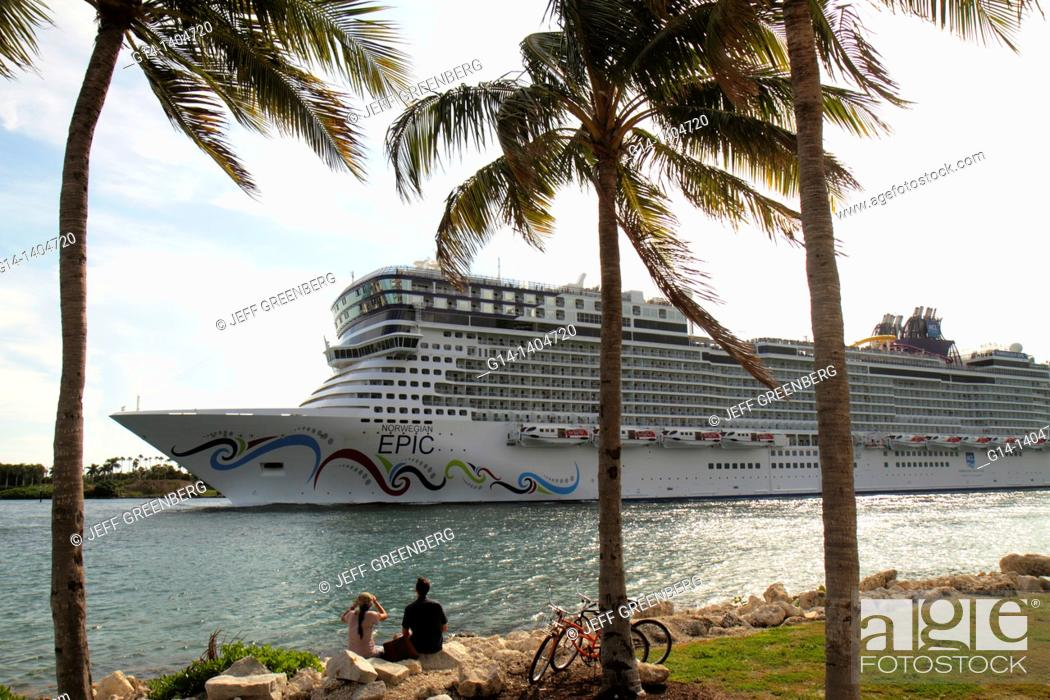 Stock Photo: Florida, Miami Beach, South Pointe Park, Government Cut, Port of Miami, departing cruise ship, Norwegian Epic, NCL, couple watching, bicycles,.