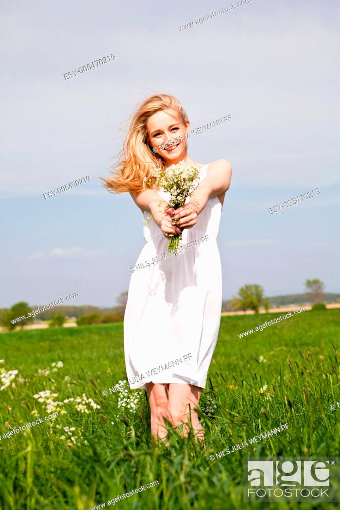 Stock Photo: beautiful blonde woman outdoor in summer happy.