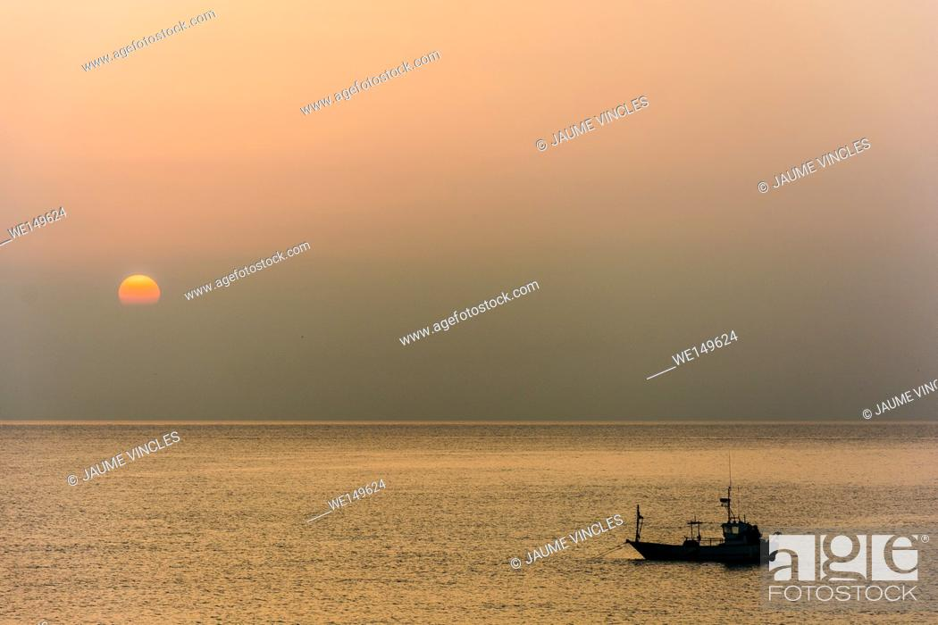 Stock Photo: Dawn and the fishing boat retreat to the most important port on the coast of Barcelona, the port of Arenys de Mar.