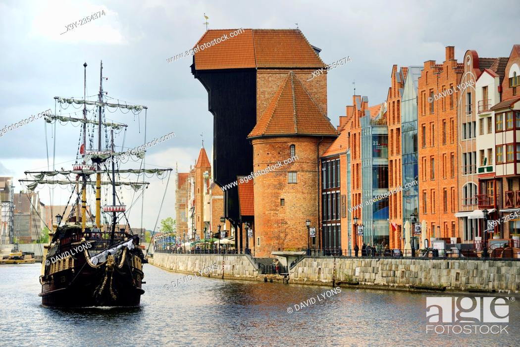 Stock Photo: Gdansk Poland. Old Town. Medieval Crane Gate rises over the Motlawa River and historic buildings on the Dlugie Pobrzeze.