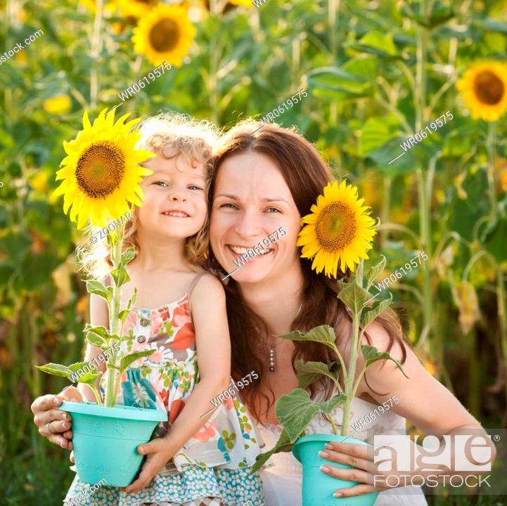 Stock Photo: Woman and child with sunflower.