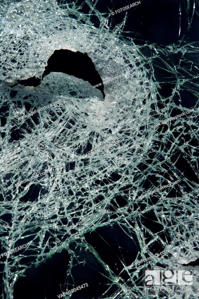 Stock Photo: Cracked glass against black background.