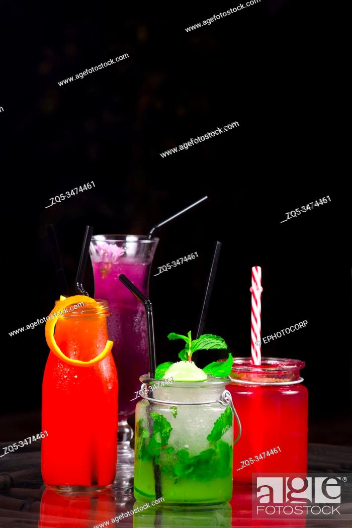Stock Photo: Different colored cocktails at a bar counter.