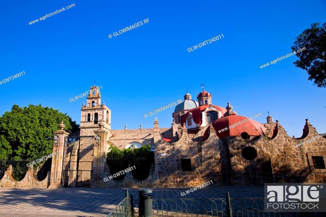 Stock Photo: Trees in front of a church, Iglesia Del Carmen, Morelia, Michoacan State, Mexico.