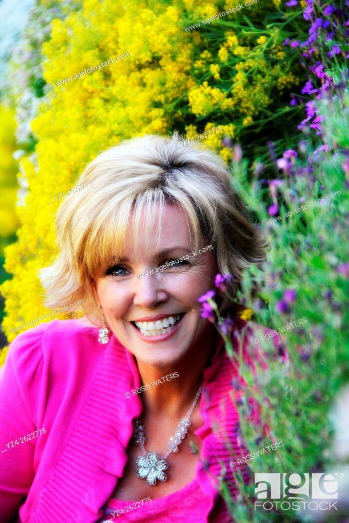 Stock Photo: Closeup of a woman outdoors in a garden in Spokane, Washington, USA.