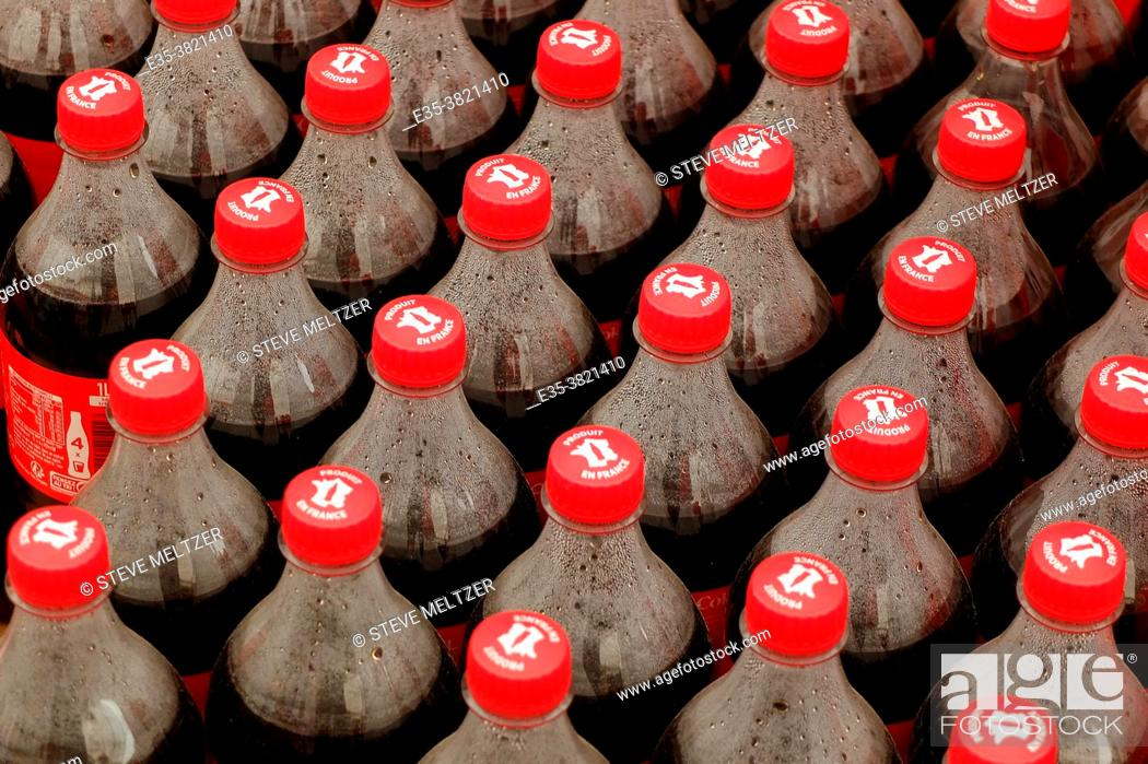Stock Photo: Cases of cola bottles waiting to be sold.