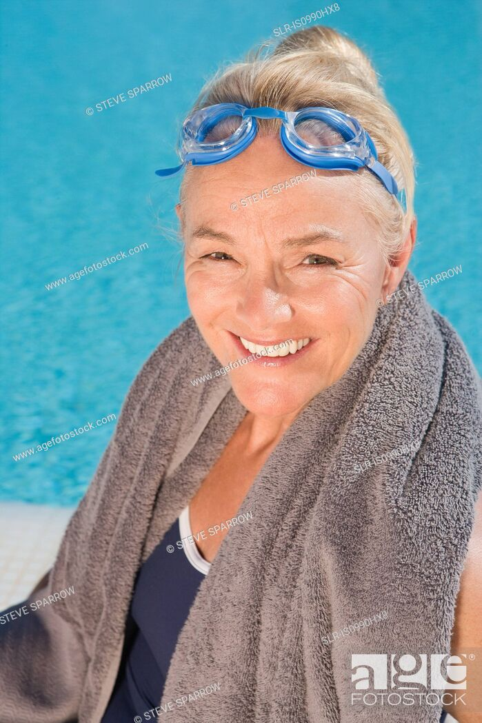 Stock Photo: Mature woman by swimming pool.
