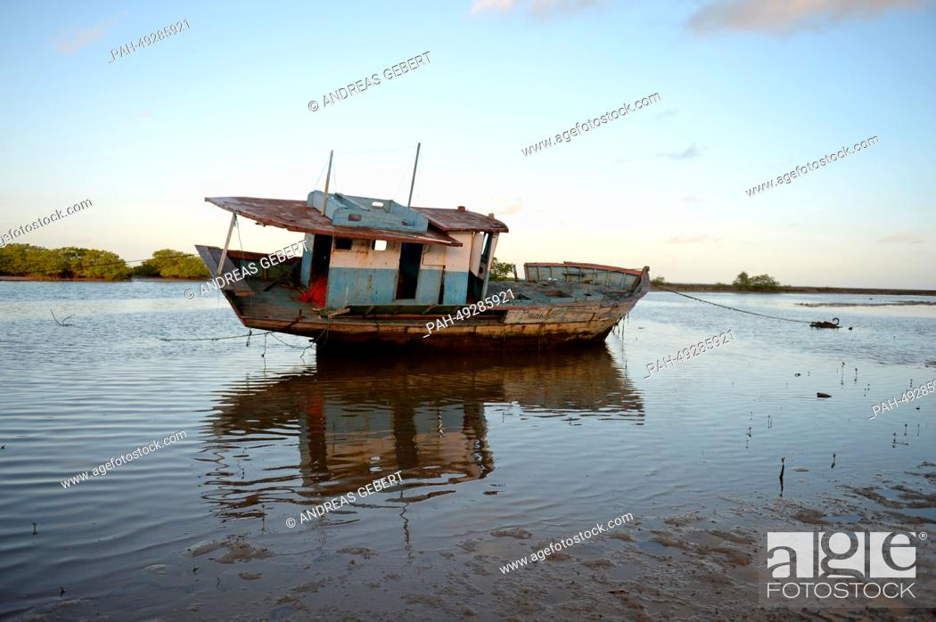 Stock Photo: A boat lies on the shore near Porto Seguro in Brazil, 09 June 2014. The German national soccer team stays in a hotel near Porto Seguro during the soccer world.