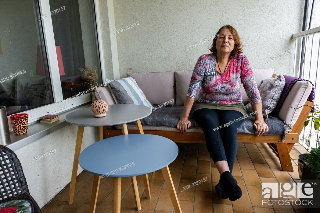 Stock Photo: Berlin, Germany. Maggie is a proud and comfortable Airbnb host at het home in West Berlin, were she hosts travellers from many countries.