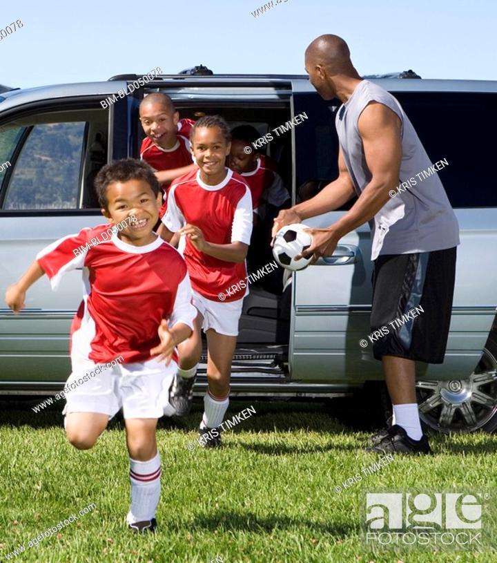 Stock Photo: Multi-ethnic children in soccer uniforms.