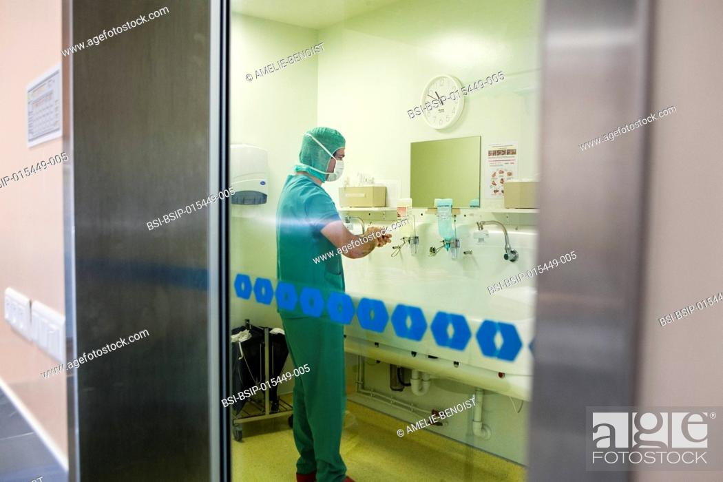 Stock Photo: Reportage in the orthopedic surgery service of Léman hospital in Thonon, France. The surgeon washes his hands before an operation.