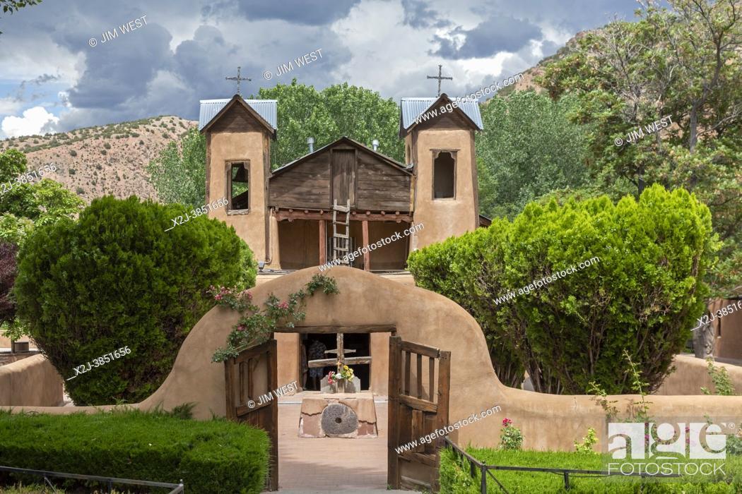 Stock Photo: Chimayo, New Mexico - The Christ of Esquipulas Chapel at El Santuario de Chimayo. The Santuario is a Roman Catholic pilgrimage shrine in the mountains of.