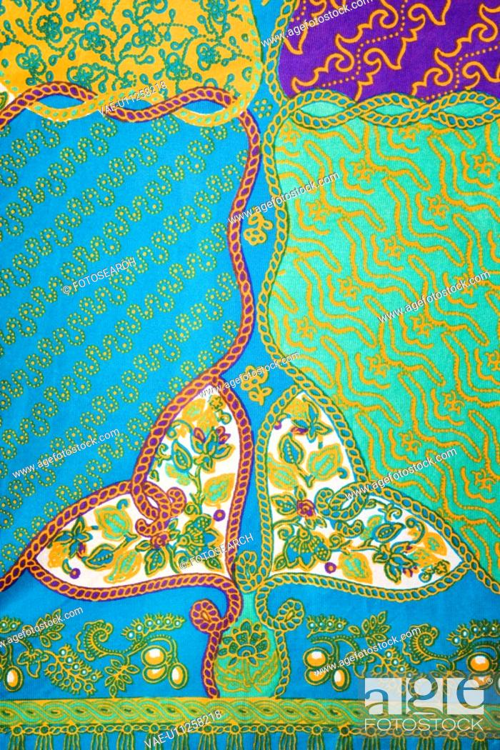 Stock Photo: Close-up of colorful vintage fabric with abstract blue and turquois shapes printed on polyester.