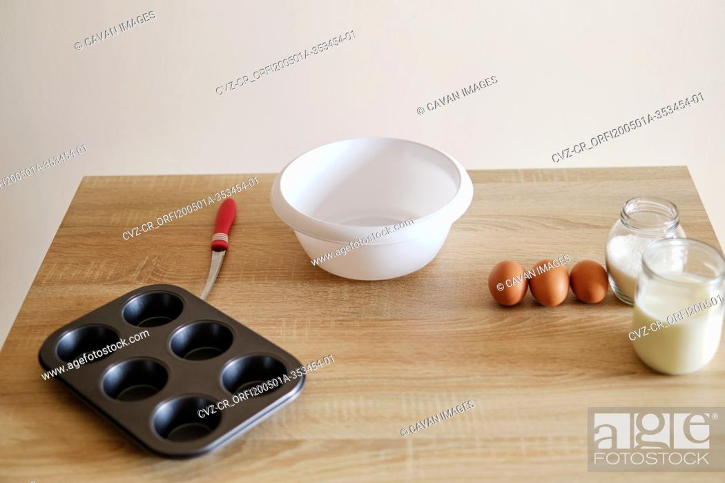 Stock Photo: cookware with baking ingredients plates and shapes waiting to cooked.