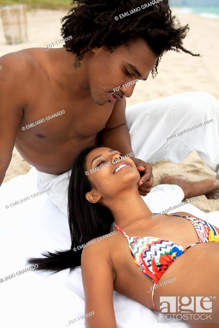 Stock Photo: An affectionate young couple at the beach.