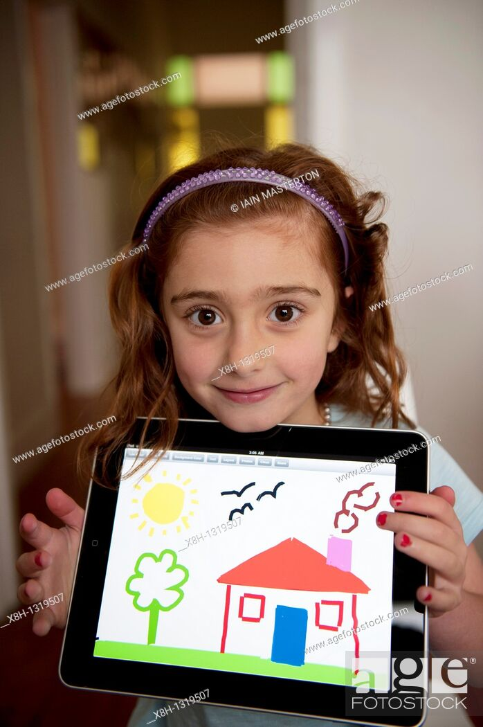 Stock Photo: Young girl showing her drawing made on painting application on an iPad tablet computer.
