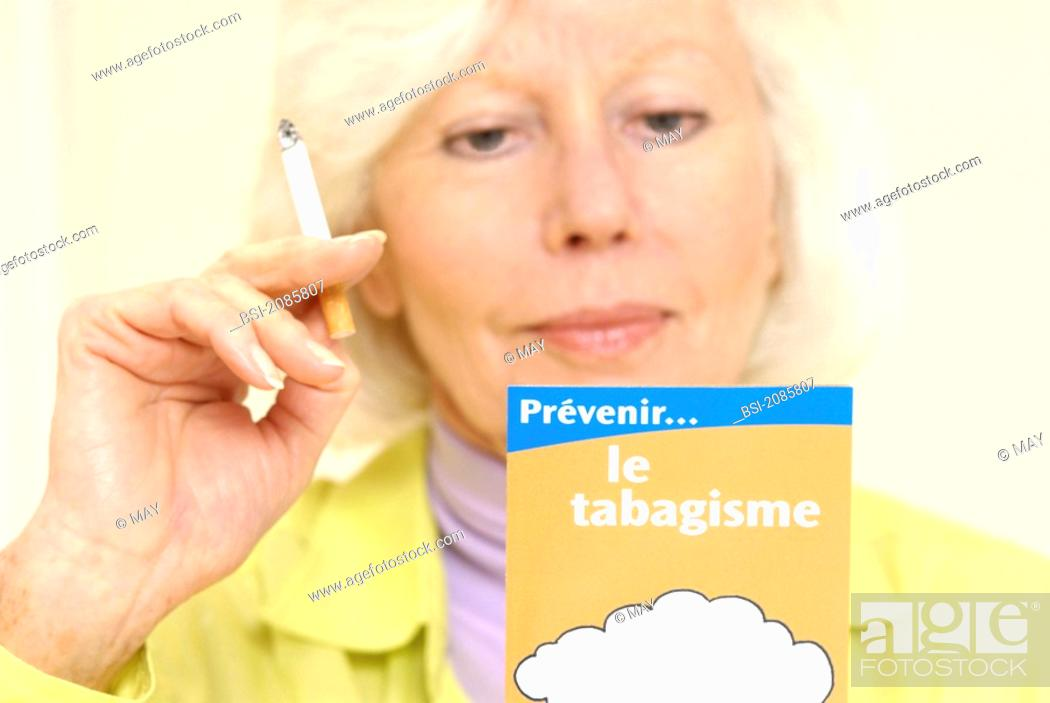 Stock Photo: ELDERLY PERSON SMOKING Model. Brochure of information on the dangers of tobacco. This brochure also informs about the persons to contact to receive help for.