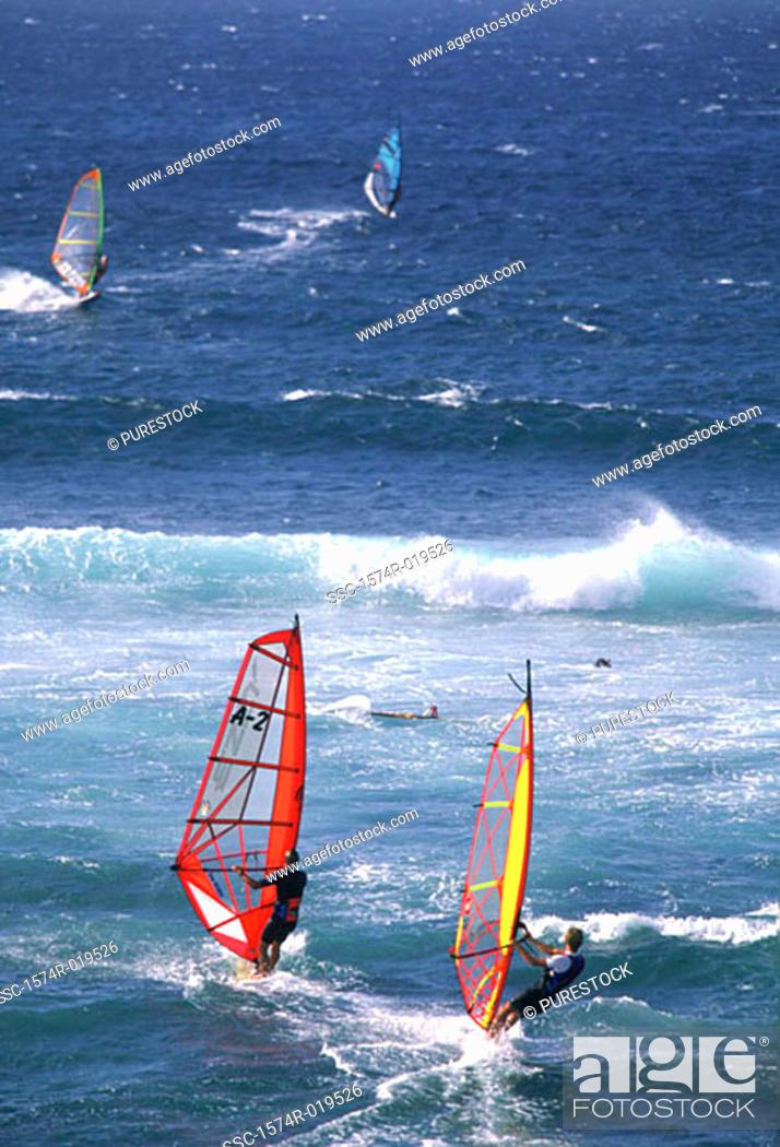 Stock Photo: Windsurfers jumping waves, Hawaii, USA.