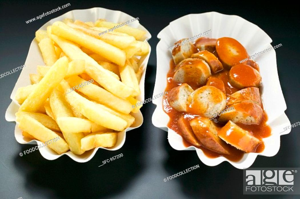 Stock Photo: Sausage with ketchup and chips in paper dishes.