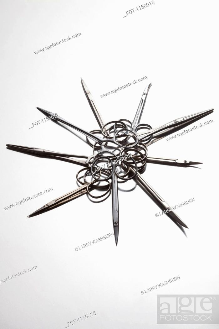 Stock Photo: A group of surgical scissors arranged in a circular pattern.