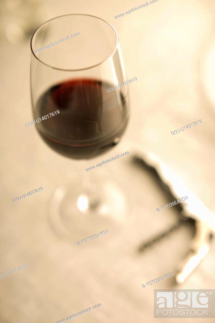 Stock Photo: Red wine and Wine opener.