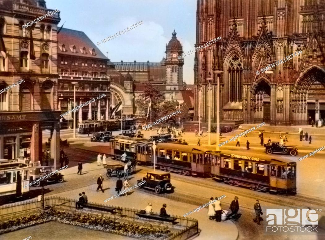 stock photo street scene of train station and public square outside the cologne cathedral in cologne germany 1950 note image has been digitally